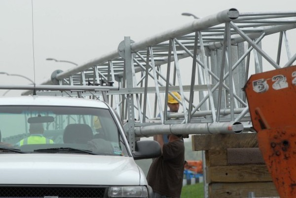 Photos by Rich DionneSakonnet Bridge workers prepare girders and other equipment used for tolls near Anthony Road.