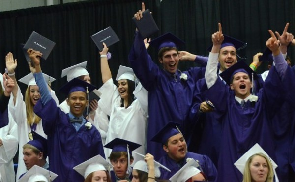 Photos by Rich DionneStanding from left, Marquis Silva, Kelsey St. George, Louis Costa, Joshua Cordeiro and Corey Gendreau celebrate receiving their diplomas.