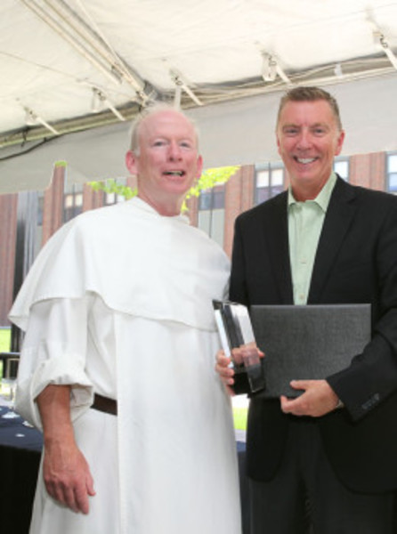 Providence College President Rev. Brian J. Shanley, O.P., stands with East Providence native Dr. John E. Deasy after he was honored by the school recently.