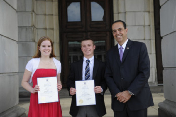 Secretary of State A. Ralph Mollis (right) presents 2013 Civic Leadership Awards to Molly Williams and Michael Miniati of Barrington High School at a Statehouse ceremony.