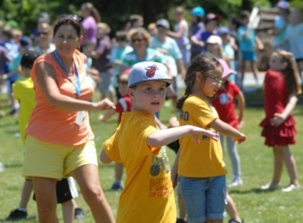 Sowams first-grader Griffin Duffy (center) and his classmates exercise during Outdoor Day on Monday.