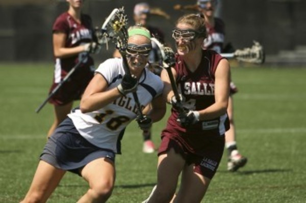 Barrington's Kelly Dolan (left) is guarded by LaSalle's Kendall McCartney during the Division l Girls Lacrosse finals, at Brown University. Barrington won the Division l championship over LaSalle, 13-10. Photo by Bill Murphy