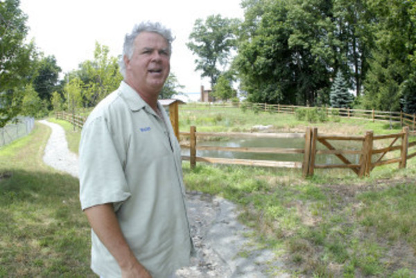 Bristol Parks and Recreation Director Walter Burke stands in front of the bio-remediation pond.