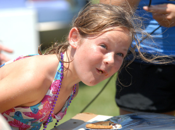 Photos by Rich Dionne and Alena AdamsPie eating contestant Martha Wilson, 8, comes up for some air during the children's pie eating contest on Saturday. She beat out five others for the first place ribbon.