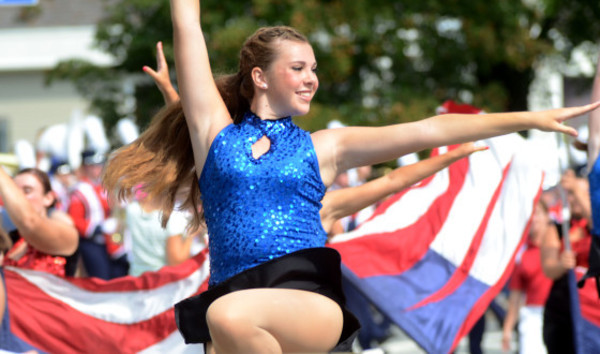 Photos by Rich DionnePortsmouth High School dancer Lindsay Peckham dances down East Main Rd. with the marching band during the parade on Saturday.