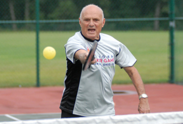"Photos by Rich DionneJim Maynard, 75, of East Providence is hoping he can instill the fervent passion he picked up for a game quirkily named ""Pickle Ball"" to some folks in his hometown."