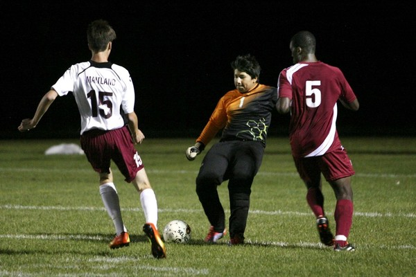 Masters Academy's goalkeeper Kevin Rodrigues (center) comes far from the net to take the ball away from Tiverton's Loagan Maitland (left) as Masters Academy's Pablo Perez moves in (right) during their earlier soccer game at Tiverton against Masters 7-0. Photo by BIll Murphy