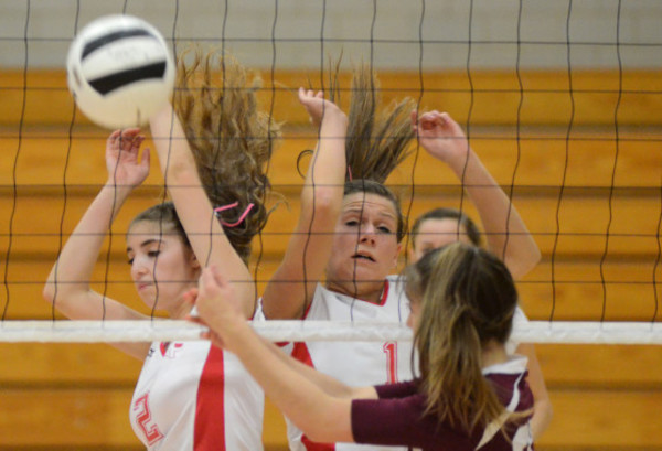 Photos by Rich DionneTownies seniors Logan Fontes (left) and Kaitlyn Bellamy tip the ball onto the Lasalle side of the net for a point in game 2 on Wednesday night.