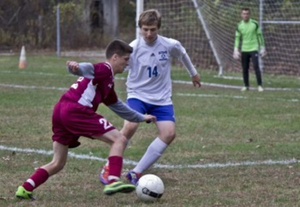 Ryan Amaral tries to work his way around a Scituate defender. TIM MARSHALL