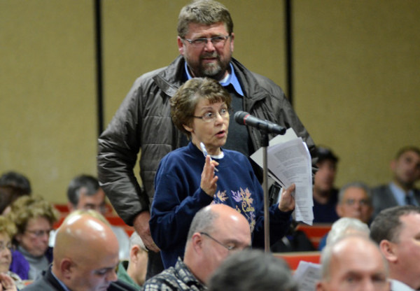 Photos by Rich DionneWestport resident Jane Young asks a question during discussion of article 15, during Tuesday night's special meeting.