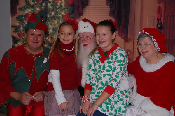 Nora Prendergast, 9, and Mia Padula, also 9, pose with Santa, Mrs. Clause and Tiny the Elf, during Sunday's Breakfast with Santa at Mt. Hope High School.