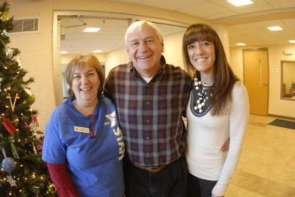 YMCA staff members Geri Purcell (left) and Meaghan McKissick (right) stand with Barrington resident Steve Holland. Mr. Holland suffered cardiac arrest and the two YMCA staff members were among a group of people to help save his life.