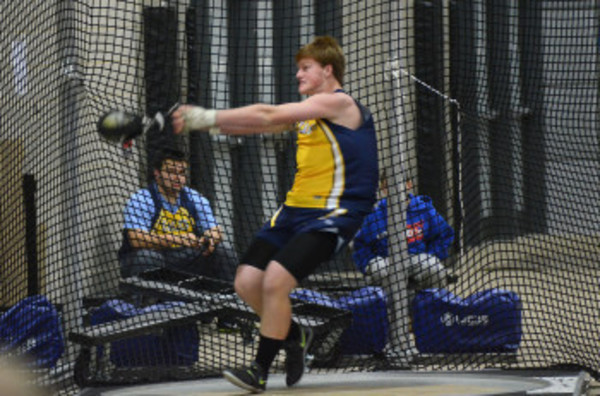 Adam Kelly competes in a prior regular season indoor track and field meet.