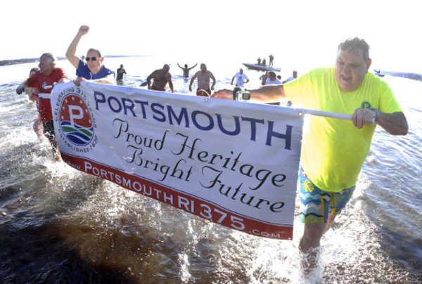 Photos by Rich DionneFrom left, Doug Smith Gary Gump and Richard Talipsky of the Portsmouth 375th Steering Committee run out of the icy water with the 375th banner.
