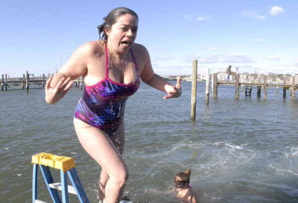 Photos by Rich DionneMollie Quelle grimaces as she emerges from the icy water at the Back Eddy on New Year's Day.