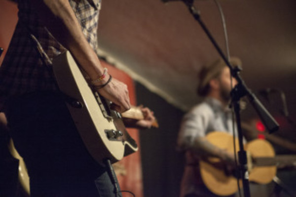 Eric Lichter (left) plays guitar during Monday's benefit show.