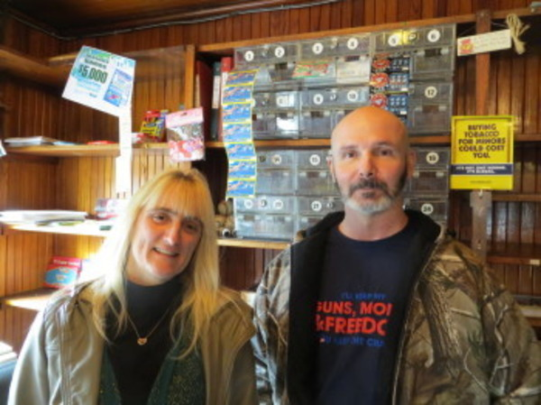 On New Year's Eve, the last day the place was open under their 15-year ownership, Jennifer Holewka and Ralph Borden stand behind the counter at Simmons Store. Photo by Tom Killin Dalglish