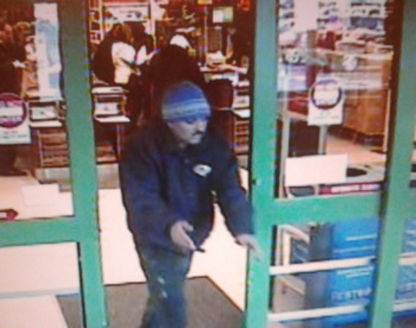 A surveillance image shows the alleged pork thief leaving Shaw's Supermarket on Dec. 31.