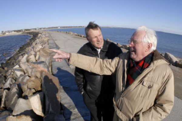 David Sprogris points toward Horseneck from the Gooseberry causeway. With him is Michael Sullivan. Both have become convinced that the causeway, by blocking the historic tidal flow there, bears much of the blame for East Beach (background) erosion and even, perhaps, for water quality issues within the Westport River.