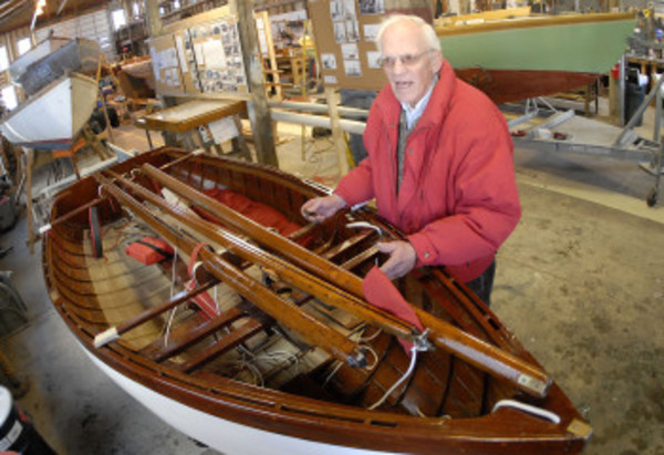 Dyer Jones with the 79-year-old mint-condition dinghy back at the museum. It will be welcomed at this weekend's Frostbiter's Bash.