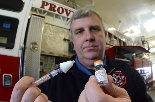East Providence firefighter Joseph Horn holds up a syringe and a vial of Naloxone, the generic drug for Narcan, which blocks the effects of heroin. The drug can be administered in two ways by the firemen. It can be administered in an iv which can counteract the effects of heroin within 30 seconds during a drug overdose. If used with a syringe through the nose, the drug can take up to 4 minutes to counteract the heroin.