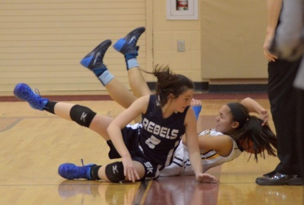 Photos by Rich Dionne                                                                                                                                             Eagles junior guard Sarah Middleton dives for a loose ball during their D-I  Quarterfinal game against South Kingstown at RIC on Friday night.