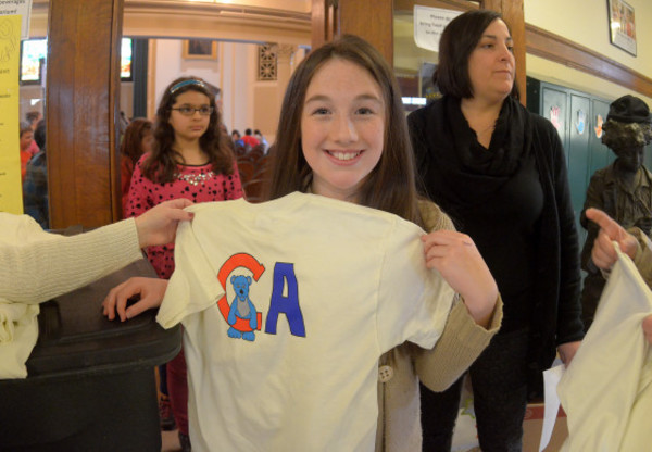 Photos by Rich DionneColt Andrews fifth grader Hannah Rodriques holds up one of the new t-shirts with her mascot design on them. On Thursday they were given out to the entire school.