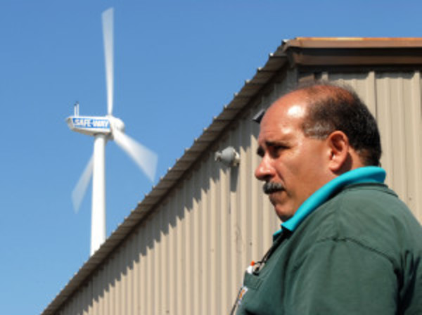 Joe Coelho, Jr., owner of Safeway Auto, installed the wind turbine behind his business two years ago.