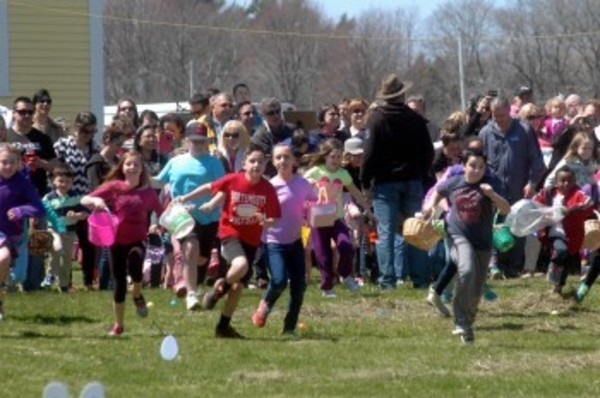 Kids are off and running at the start of the first egg hunt.