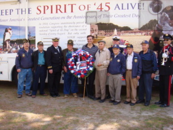 Among thiose standing in front of Spirit of '45 vehicle are, at center, Martin Costa and his father George Costa. Lino Rego is at far left, and Austin O'Neill its at right which his bugle.