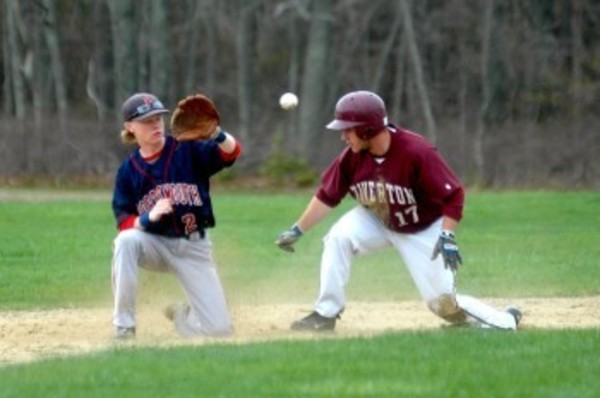 Patriots second baseman Conor Struckman waits for the ball as he tries to tag Tiverton's Christopher Almeida out.