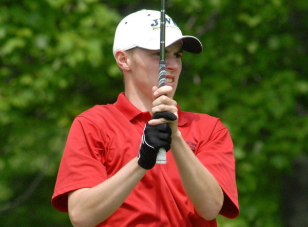 Photo by Richard W. Dionne Jr.: Portsmouth's Jake Bauer eyes a tee shot during the opening round of the state golf tournament, May 27.