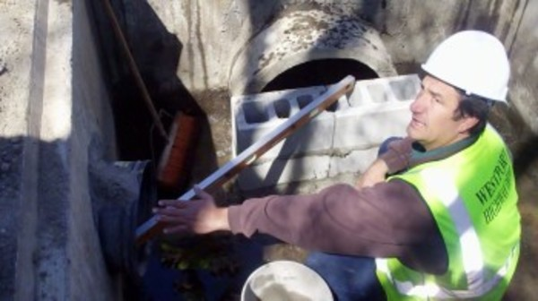 An admitted 'hands-on guy,' new Highway Surveyor Chris Gonsalves works on a drain pipe.