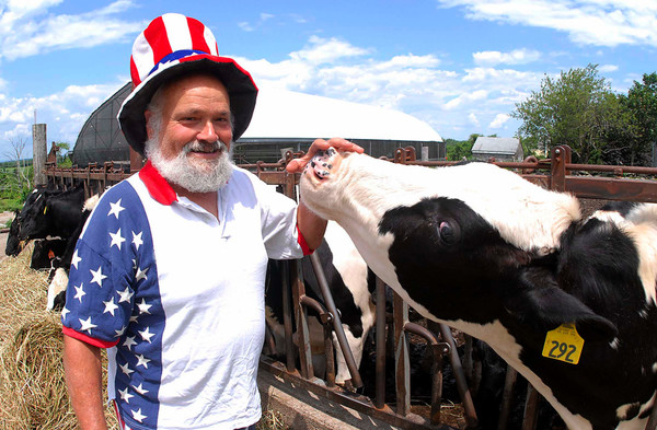 "Louis Escobar, here posing with a friend, dresses up in Patriotic garb for every Independence Day. ""I'm Uncle Sam's brother,"" he says. Photo by Richard W. Dionne Jr."