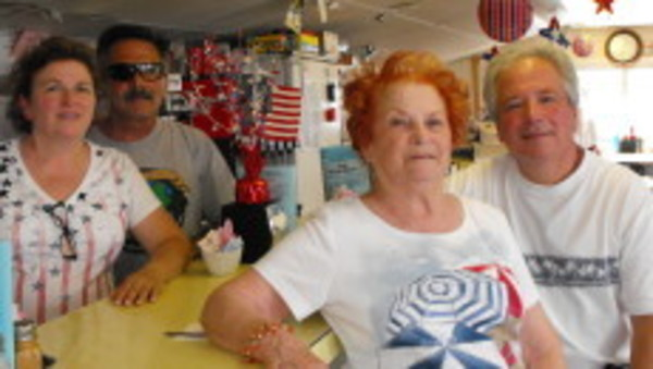 The Silva family, Lorene, Robert, Dorothy and Bruce sit inside Hope Diner remembering Mickey.
