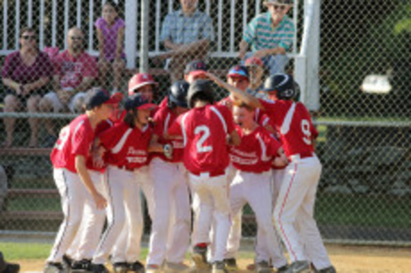 The Portsmouth 12-year-old All Star team celebrates following its district title victory over Barrington Saturday. Photo by Tim Marshall.