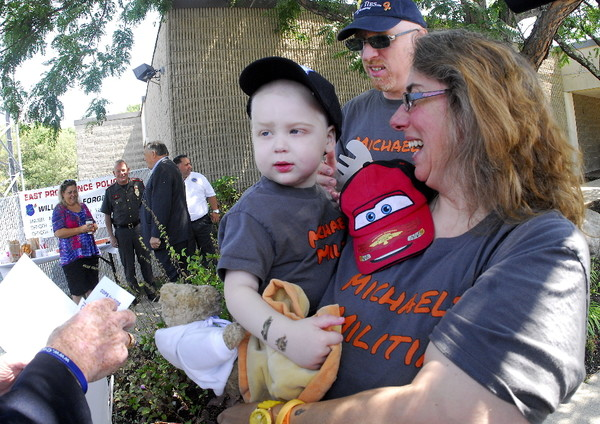 Photos by Richard W. Dionne Jr.: Michael Ryder rests in the arms of his mother, Lynne, with father Jonathan right behind after Friday's event.