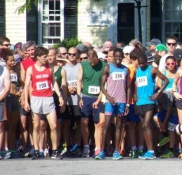 Andrew Springer (red shirt left), Amos Sand and Glarius Rop (toward the right), the top three finishers, await the start. (Dawn Ross photo)
