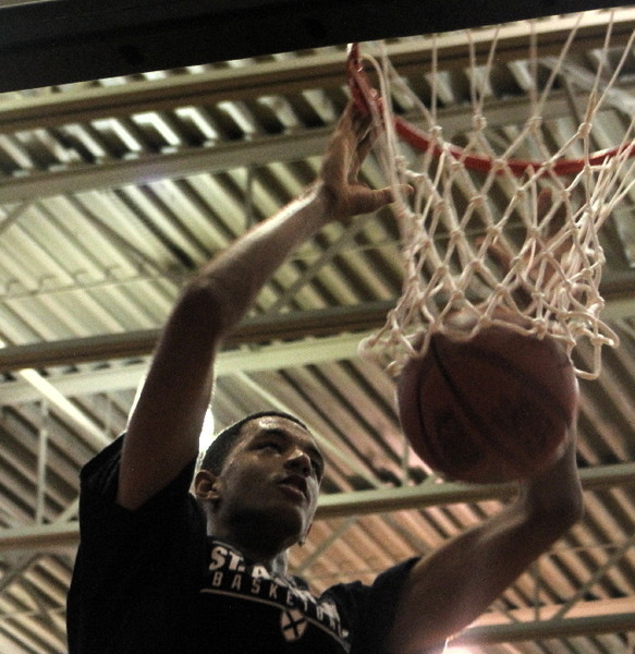 East Providence native Terrell Brown dunks during warmups prior to the St. Andrew's basketball scrimmage Monday, Aug. 11.