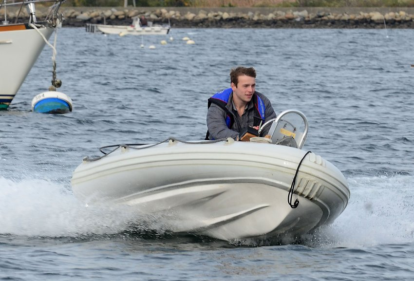 Jonathan Lord, Flux Marine's Chief Technology Officer, takes Flux's prototype electric motor out for a zippy test drive on Bristol Harbor.