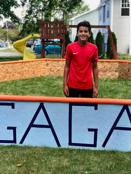 Kayleb Ruszczyk inside the GaGa ball pit he built for his yard last year. He brought his idea for a GaGa ball program to the Portsmouth Recreation Department.