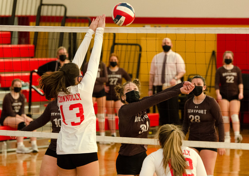 Junior middle hitter, Sophia Terra, drops a volley over the net during the wildcats 5-set win over Bishop Connolly on Wednesday.