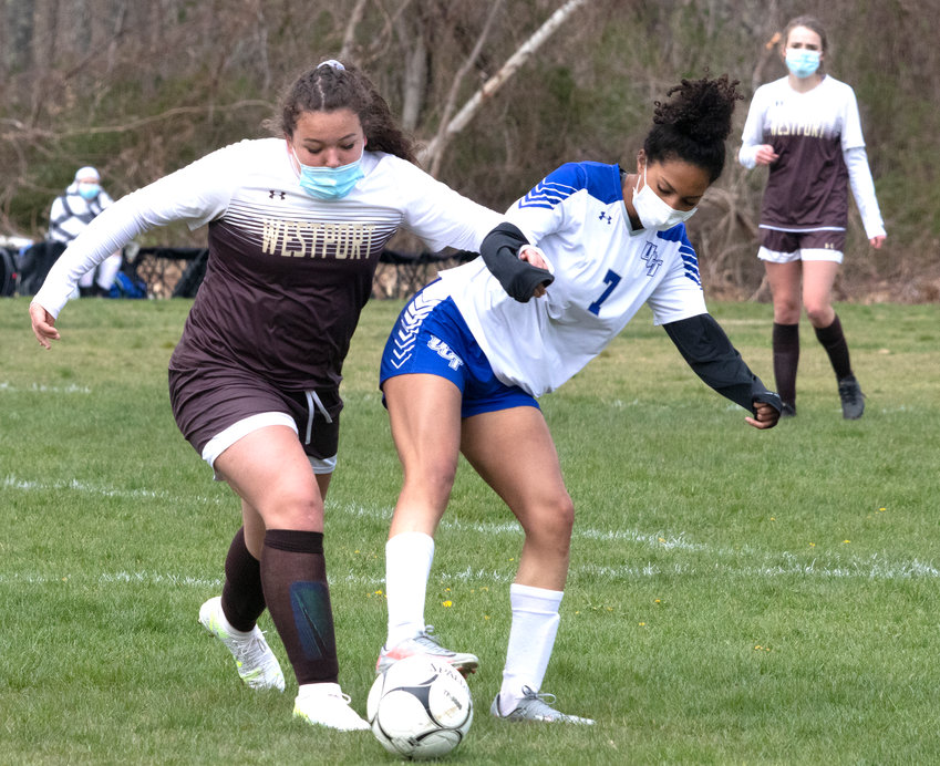 Junior striker Alora DeFonseca battles for the ball with Mya Lewis during their Wildcats home game against Upper Cape Cod Vo-tech on Thursday.