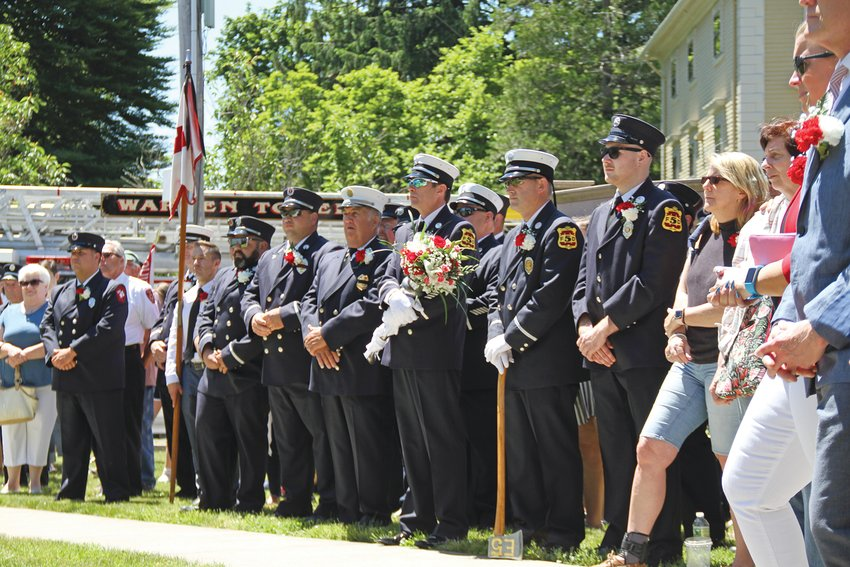 Firefighters line up at attention during the last public Firefighters' memorial ceremony held in Warren, in 2019.