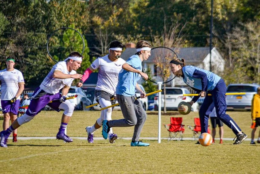 A John Hopkins University team competes in a recent game of quidditch, which is coming to Glen Park next month. Note the hooped goal posts in the background. (Photo courtesy of Ruthie Wood of Portsmouth, who plays for a John Hopkins team.)