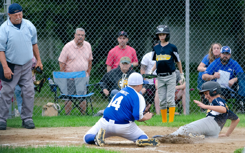 Rocco DeFonseca is called safe at home, after stealing on a wild pitch in the bottom of the sixth inning, to give Barrington a walk-off 1-0 win over Darlington at Chianese Field on Sunday night. Teammate Zach Sheinberg looks on.