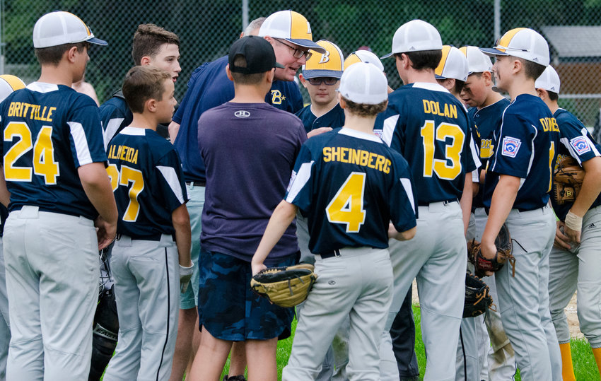 Barrington Majors Division Manager Will LoVerme (center) speaks to his team during a game last weekend.
