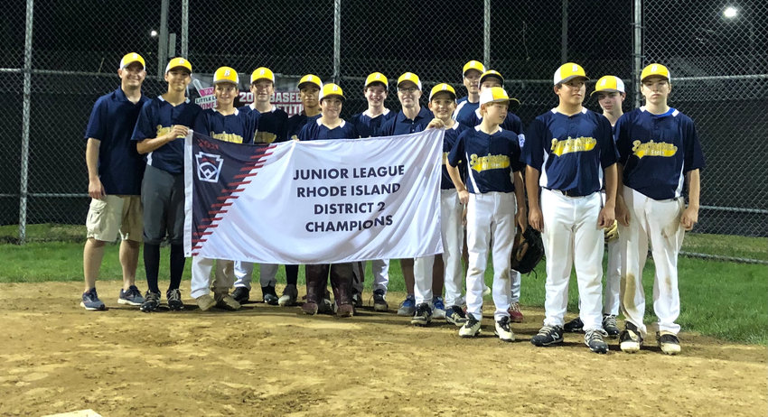 Members of the Barrington Junior Division All-Star baseball team pose with the District 2 championship banner after defeating Pineview on Sunday night.