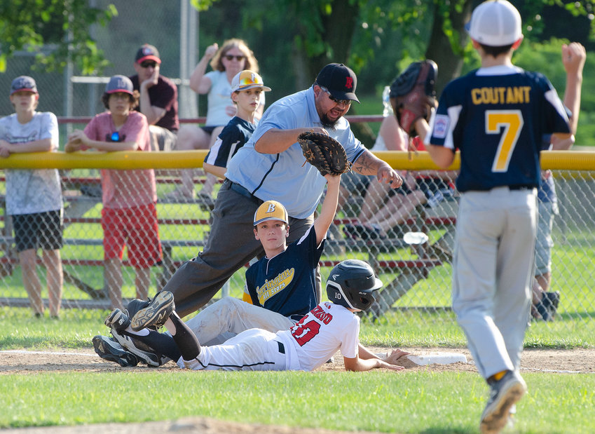 Barrington's Finn LoVerme delivers a strike during the second game of the District 2 Championship. Barrington and Riverside played until it became too dark, forcing the continuation of the game on Tuesday afternoon.