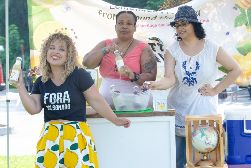 """Organizer Mariana Silva-Buck enjoys a moment at the first of her """"block parties"""" in Barrington last week."""